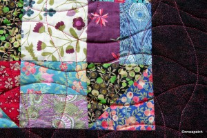 Detail of quilting on Churn Dash quilt